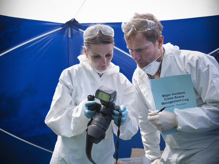 in twos: Forensic scientists at crime scene LANG_EVOIMAGES