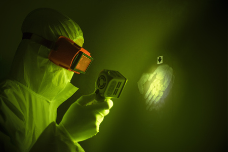 Forensic scientist with handprint LANG_EVOIMAGES