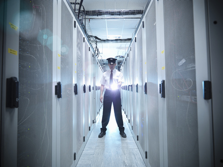 safeguarded: Security guard in server room