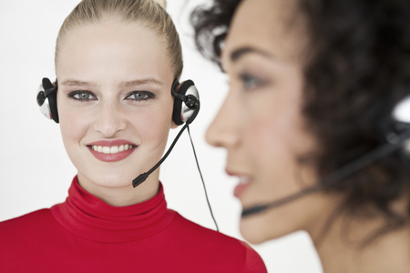 hands free device: Businesswomen wearing headsets