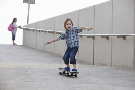 exhilarating: Boy riding skateboard on ramp