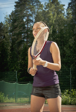 staying fit: Tennis player holding racket on court