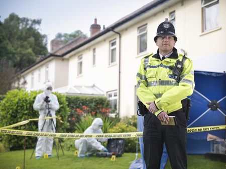 safeguarded: Policeman guarding forensic crime scene LANG_EVOIMAGES