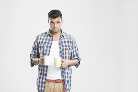 somber: Man holding cups of coffee