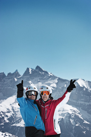 defended: Skiers cheering on snowy mountain LANG_EVOIMAGES