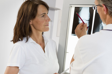 Doctor and nurse examining x-rays LANG_EVOIMAGES