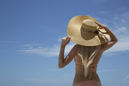 Woman wearing sunhat and bikini