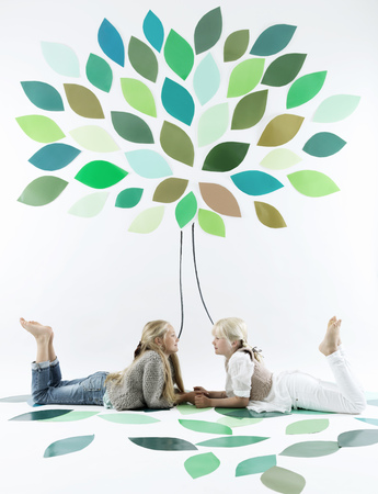leafed: Girls talking under tree on wall