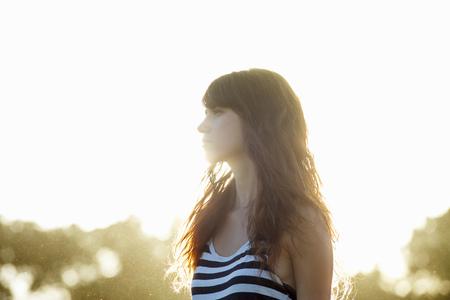 musing: Woman walking outdoors