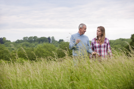 the elderly tutor: Father and daughter in tall grass