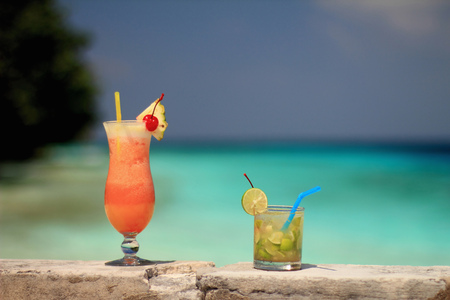 edge: Tropical drinks on rock wall
