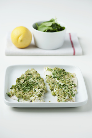 Plate of herb encrusted bass filets