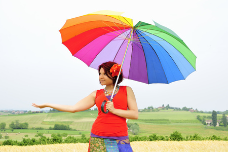 Woman holding colorful umbrella