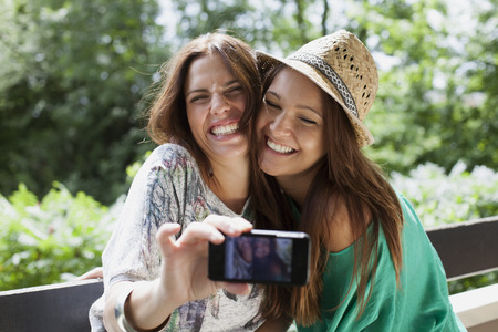 hearted: Women taking picture of themselves