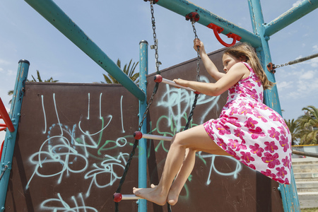 scaling ladder: Girl on playground ladder outdoors