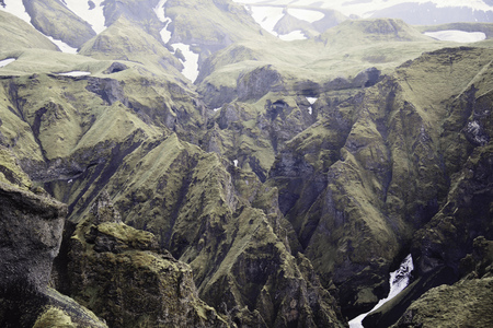 Frozen streams on rocky mountainsides LANG_EVOIMAGES