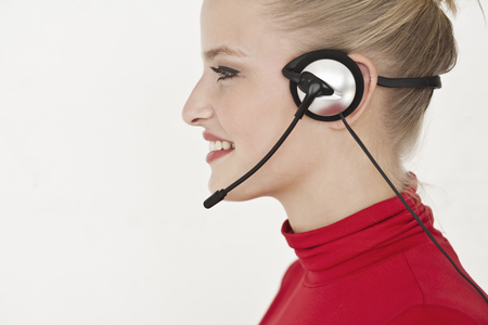 responded: Businesswoman wearing headset LANG_EVOIMAGES