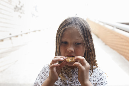 morsels: Girl eating cookie outdoors