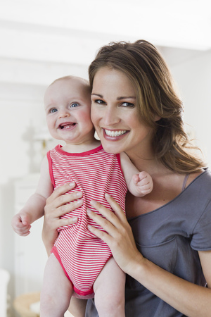 zeal: Smiling woman holding baby
