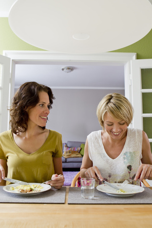 gratify: Smiling women having lunch together