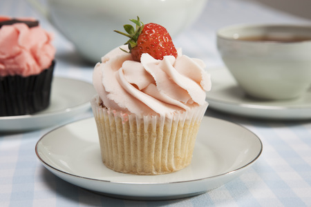tempted: Close up of cupcake with strawberry LANG_EVOIMAGES