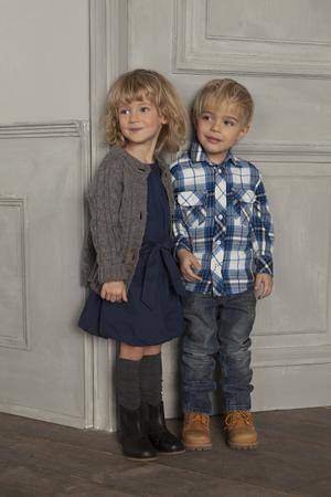 rejoices: Children smiling together indoors