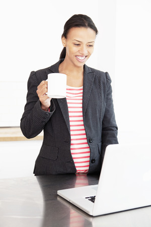 mornings: Businesswoman working with cup of coffee