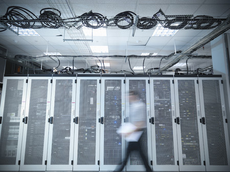 rushed: Blurred view of man in server room