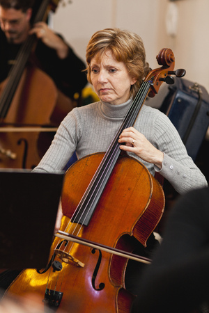 coordinating: Cello player practicing with group