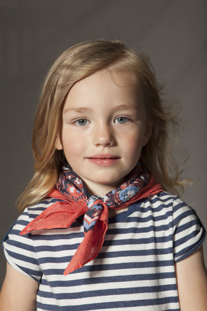 Girl wearing silk scarf in studio LANG_EVOIMAGES