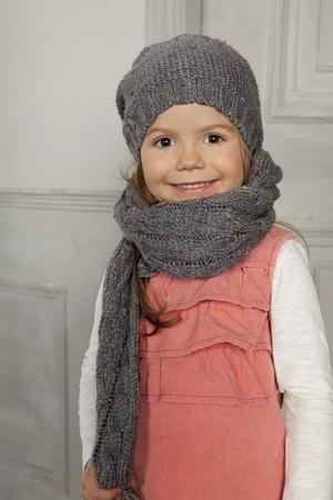 enthusiastically: Smiling girl wearing hat and scarf LANG_EVOIMAGES