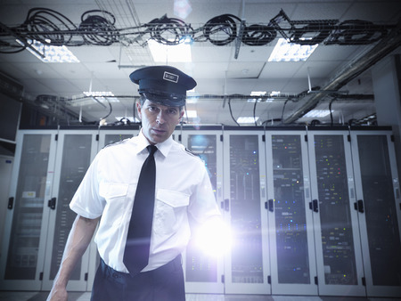 Security guard standing in server room