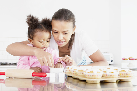 preparedness: Mother and daughter baking together