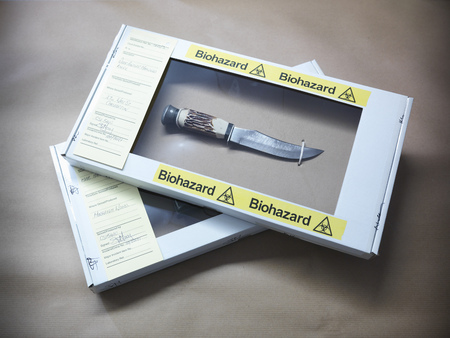 cautions: Knife in forensic biohazard box LANG_EVOIMAGES