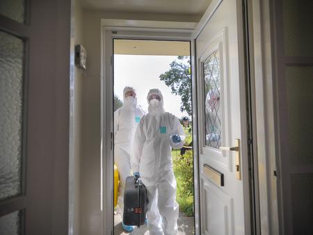 Forensic scientists at crime scene LANG_EVOIMAGES