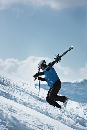defended: Skier climbing up snowy mountainside