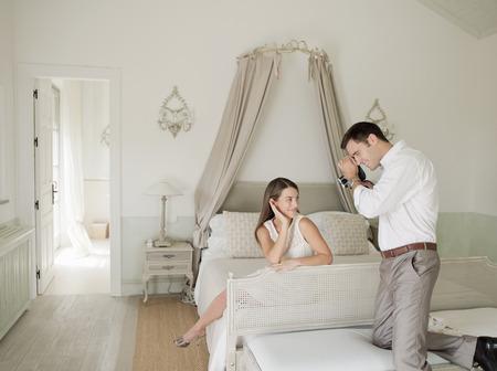 lavishly: Woman having picture taken in bedroom
