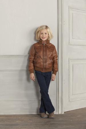 chic woman: Girl wearing jacket indoors