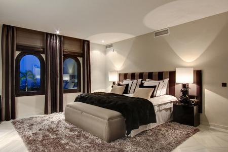 lavishly: Bed and windows in modern bedroom