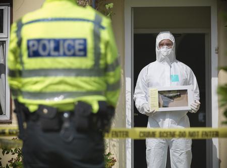 safeguarded: Forensic scientist at crime scene