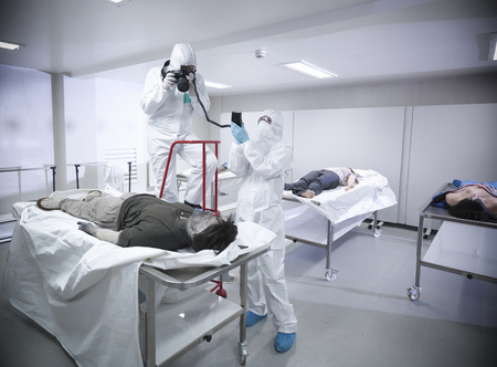 Forensic scientists with false corpse LANG_EVOIMAGES