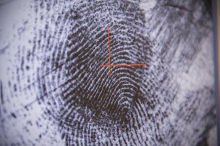 identifiers: Fingerprint on screen in forensic lab