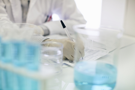 protects: Scientist working in lab