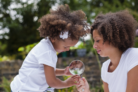 Mother and daughter playing outdoors LANG_EVOIMAGES