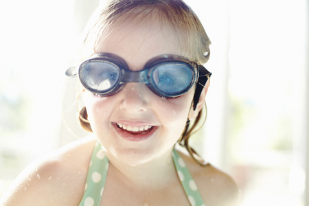 Smiling girl wearing goggles