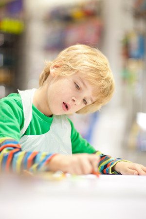 Boy concentrating on drawing