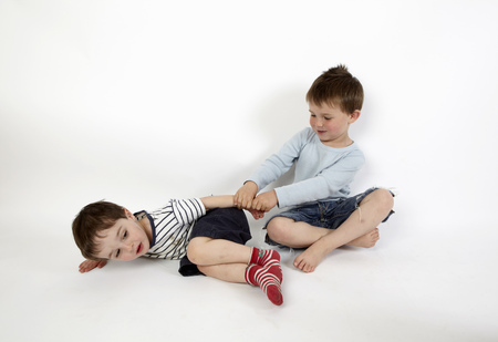Boys playing together on floor