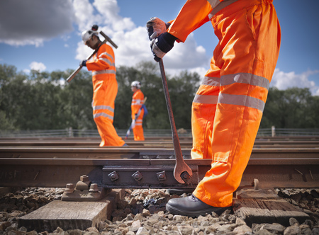 Railway workers adjusting train tracks LANG_EVOIMAGES