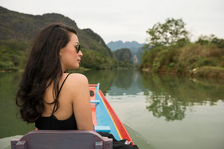 Woman on boat on Nam Song River,Vang Vieng,Laos LANG_EVOIMAGES