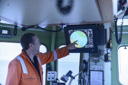 Tugboat: Tugboat worker examining map
